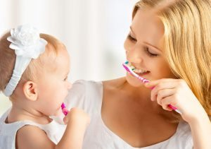 Start good brushing habits as soon as your child's first tooth appears
